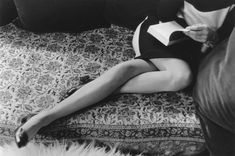 Henri Cartier-Bresson rarely shot women in an intimate, sensual manner.   The photo of his wife Martine Franck, however, is a delicate image, charged with the latent promise of those intertwined legs.