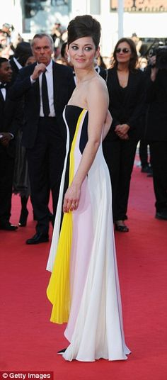 Serious style: Some of her most memorable looks at Cannes have included a clean cut draped monochrome and yellow dress in 2013 (L) and a showstopping grey midi-dress the following year (R)