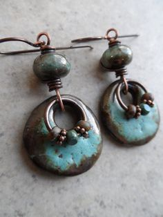 Awesome ceramic charms, handcrafted by Jana Bližňáková, and beautiful copper green lampwork beads, handcrafted by Julie Burgard, are wire-wrapped