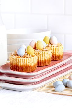 Mini cheesecakes with vanilla wafers are the ideal Easter desserts for children and adults. These cheesecake bites feature a vanilla wafer crust, a luscious rich filling, and a bird's nest on top: shredded coconut with candy eggs. Serve these mini desserts for Easter brunch, Mother's Day, baby showers, and special occasions all spring long. Make this easy mini cheesecakes recipe in a muffin tin or cupcake pan. Pin now for later!
