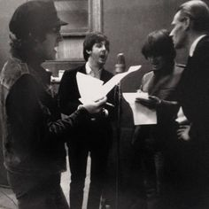 John Lennon, Paul McCartney, George Harrison, & George Martin in the studio, c. 1965 (probably working on the Help! album)