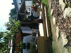 Backyard deck and tiki bar by All Things Savvy,Inc.