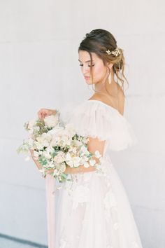 """From the editorial """"A Fantastical Floral Staircase Is Just The Start Of This Fairytale Day"""". There's just something about muted florals that makes our heart skip a beat. 💗   LBB Photography: @laurenfair #stylemepretty #weddingflowers #weddingflorals #weddingbouquet #weddinginspiration Wedding Dress Quiz, Blue Wedding Dresses, Tea Length Wedding Dress, Wedding Dress Shopping, Long Sleeve Wedding, Floral Wedding, Wedding Bouquets, Flower Girl Dresses, Wedding Flowers"""