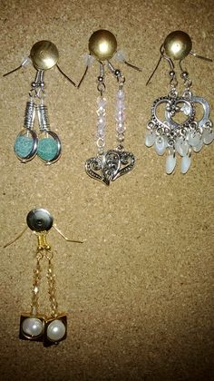 A collection of earrings for the Blue Cross