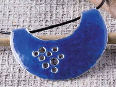 pierced enameled pendant by Pauline Warg - from Making Enameled Jewelry: Champlevé, Cloisonné, and Other Kiln and Torch Enameling Techniques - Jewelry Making Daily