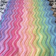 One colour repeat sequence thing done! not shown in this photo are the 55 ends to weave in Yarn is stylecraft special DK in cloud blue sherbet spring green lemon apricot candy floss fondant clematis and wisteria. Credit to @crochetcreationsbyhanan for the inspiration #crochet #crochetblanket #rippleblanket #attic24ripple #stylecraftspecialdk #crochetersofinstagram #crochetlove #bhooked by carefulscrochet