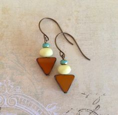 Glass Arrows~    Pretty glass beads stacked in a row make the lovely arrow earrings. These have oversized brass ear wires, if you would prefer