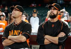 Pitchers Tim Hudson #17 and Ryan Vogelsong #32 of the San Francisco Giants stand on the field before the Opening Day MLB game against the Arizona Diamondbacks at Chase Field on April 6, 2015 in Phoenix, Arizona. (April 5, 2015 - Source: Christian Petersen/Getty Images North America)