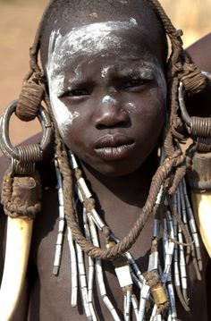 Africa | Mursi girl. Omo Valley, Ethiopia | ©Corrin Phillips //