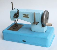 Toy sewing machine labeled Casige, made in West Germany