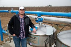 """US Department of Agriculture: """"Michael Vandborg stands in front his drought stricken vineyard in the Lamont farming community in southeaster..."""