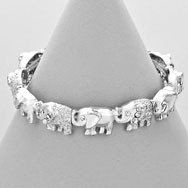 Silver tone elephant stretch bracelet with rhinestone accents.