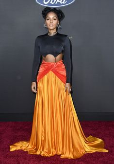 Janelle Monáe from 2020 NAACP Image Awards Red Carpet FashionJanelle Monáe from 2020 NAACP Image Awards Red Carpet Fashion The performer's colorful outfit featured a vibrant yellow skirt.Janelle Monáe from 2020 NAACP Image Awards Red Carpet Fashionn Balmain Dress, Metallic Dress, Red Carpet Looks, Blue Carpet, Colourful Outfits, Red Carpet Dresses, Red Carpet Fashion, Nice Dresses, Celebrity Style