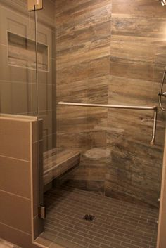 """Tile: 12X24 and 2x6 Ready to Wear Hats Off, 8x48 Boardwalk Coney Island Walnut; Shower Door: 3/8"""" Clear Glassed with Brushed Nickel Hardware, 8"""" C-Pull with Towel Bar and Standard Hinges"""