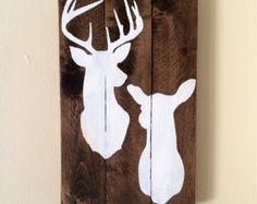 Rustic hand painted Deer silhouette pallet sign Approximate size: 10.5 x 16.5  Items are made to order so if you would like a different color combo please message me with those details.  Because each sign is custom made please allow 2-4 weeks for production and I will ship within 1-3 days after it is completed. If you need it sooner please message me before purchasing and we will work it out.  All signs are created from cut wood, reclaimed barn wood, or pallets so please be aware some may…