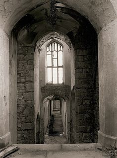 Gwrych Castle Ruins, Abergele, Denbighshire, Wales. In the 1970's a psychic woman visited Gwrych castle. Whilst there she was drawn to a particular room in the servants quarters, the men's room. She set off to investigate, but near the servant's stairs she has an horrific grasping pain in her chest and collapsed. (In 1915 the Butler suffered a fatal heart attack on these stairs.)