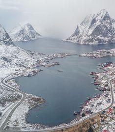 Into the snowy fjord, Reine, Reinefjorden, Lofoten Islands (Norway)
