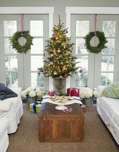 Christmas... love the idea of a coffee table tree in one of the living rooms!