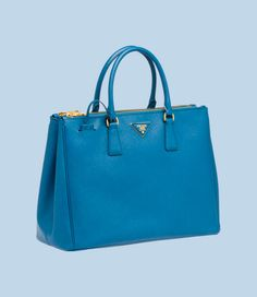 Prada Galleria capsule collection, named after the brand's first, historic store. Saffiano calf leather tote in cobalt.