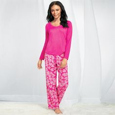 Lightweight pants with a cute heart print and a solid-pink long-sleeve top. Cotton/polyester. Machine wash and dry. Imported.