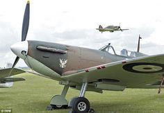 Ready for take off: The Eagle Squadrons Supermarine Spitfire is pictured with the Hawker Hurricane above