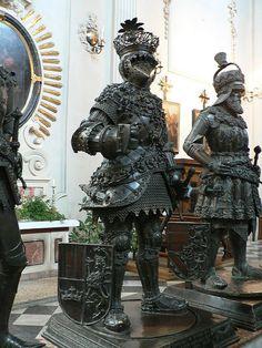 Sculptures guarding the tomb of Habsburg Emperor Maximillian I, Hofkirche in Innsbruck, Austria  by gmh1971, via Flickr
