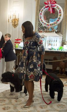 FLOTUS Michelle Obama With her dogs Sunny and Bo, at the White House's unveiling of the 2016 holiday decorations for military families and their children.