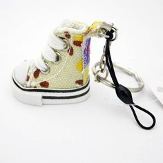Promotional mini sneaker key chain, mini tennis shoe key chain, vivid color, custom logo available. Size: 7.5cm Small and special order are welcome 1)Experienced technical staff...