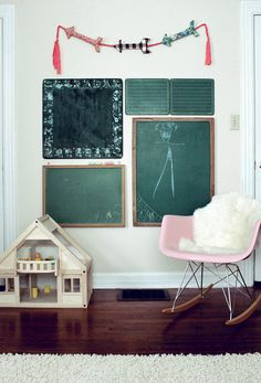 A collections of vintage chalkboards is a genius idea for decorating a kid's room.