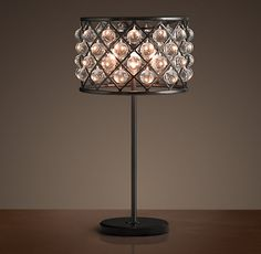 """Restoration Hardware - Spencer Table Lamp $1195 An inspired design from the British workshop of Timothy Oulton, our Spencer lighting collection's crystal spheres hang like gems within its iron grid.     Overall: 15¾"""" diam., 30½""""H     Weight: 41.5 lbs."""