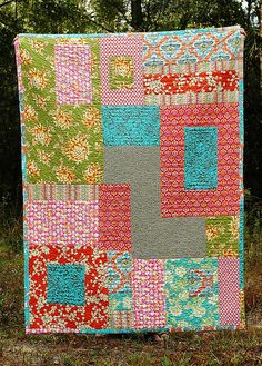 lap quilt by naturemomm (karen moore) using amy butler fabric via flickr.