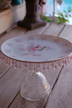 Isn't this cute? Inexpensive wine goblet with pretty plate glued and jewel fringe. Chic n clever