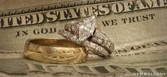 "Great photo of wedding rings and ""In God We Trust"" in the background.  Photo by Jeff Kolodny Photography"