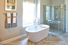 Relaxing and spa-like Master Bathroom by Shaddock Homes at Phillips Creek Ranch #FreestandingTub #ShaddockHomesTX