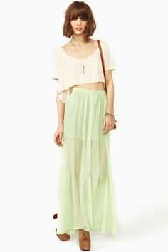 Lost Spring Maxi Skirt: Flowy mint chiffon maxi skirt featuring a high waist and button closures. Partially lined. Looks amazing with a crop top and lace-up boots!