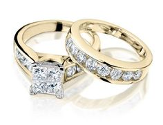A classic diamond and gold wedding ring and engagement ring set. The ultimate in bling.