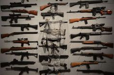 Artist Liu Bolin Became One with Weapons in the 'Gun Rack' #Art trendhunter.com