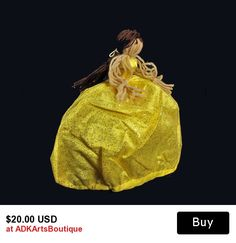 Folk Art Primitive Girl Doll Toy   This is a folk art doll on her way to a night out to the evening ball. In bright yellow she is bound not to be missed. Her dress is covered in glitter and she will be the life of the party. Will she find her Prince Charming, well, that's up to you.  This folk art doll is like one of the first dolls I ever had. My mother taught me to make these. She learned to make these herself when she was a little girl by her mother. The clothes are new and fit a Barbie…