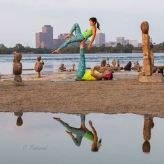 We really like this picture by Cindy Eastwood. We often get so focused on the asana that we forget how beautiful  the in-between movements can be.  #Perspective #Acroyoga #AcroyogaOttawa #PartnerAcrobatics #Balance #RemicRapids #Reflection #Ottawa #OttawaYoga #Yoga #PartnerYoga #FitCouple #Fitspo #Strength #Acrobatics #MyOttawa #Canada #Fun #Smile