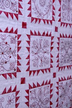 I adore the red and white embroidered quilts!  http://rosaliequinlandesigns.typepad.com