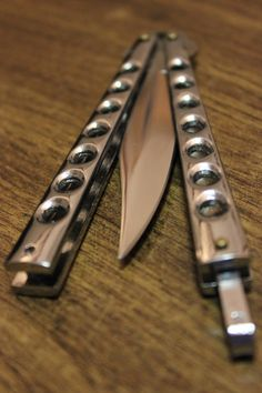I walk in with a few pieces of metal, wire, and three butterfly knives. I place them on a table and set a timer for 4 minutes. I immediately start constructing a triple Butterfly knife. I make it within 3 minutes. I look around, but they are not paying attention to me.They weren't. Go figure. The cake has been brought out. I feel so much anger, I throw my triple butterfly knife into the cake. I bow and say thank you, and