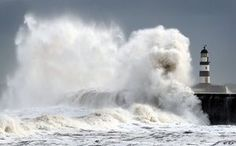 Waves crash into the sea wall at Seaham harbour, England