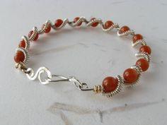 ON SALE Silver coiled wire bracelet carnelian by DianaShyeJewelry, $37.40