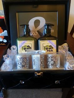 "bridal shower gift basket for my sister-in-law- purchased a small chest and gave the bride to be candle holders with candles, olive oil hand soap and lotion, and a picture frame with bride's & groom's name and wedding date. filled it with loose ""diamonds"" for finishing touch"