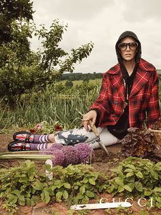 On the grounds of Chatsworth House with new men's pieces in the Gucci Cruise 17 campaign. A tartan wool coat, hooded sweatshirt acid wash jeans and the Union Jack Horsebit loafers.