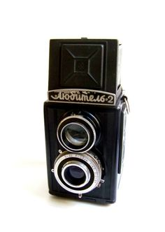 Functional VINTAGE CAMERA LUBITEL -Lubitel means amateur  -produces between 1954-1980  -plastic body  -focusing distance from 0,8  - lens with apertures