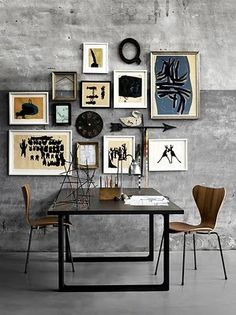 Dining Room with mixed art wall, concrete floor and wall....like the diverse shapes and textures.