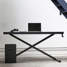 XTable is a minimal desk created by Denmark-based designers KiBiSi. XTable is a manually height adjustable desk. A piece of office machinery.