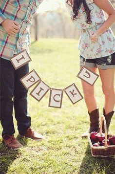 Cute engagement pic idea, since we live in apple country!!