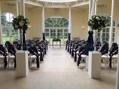 Striking navy blue ceremony room set up with beautiful navy satin sashes tied into a regal style on lime wash chiavari chairs x
